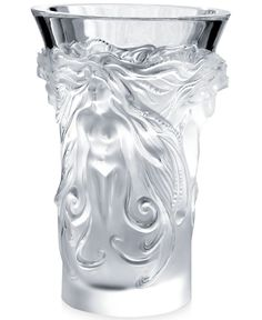"This ornately designed vase from Lalique features figural details that add plenty of rich appeal to any tabletop in the house. | Crystal | Hand wash | Imported | Dimensions: 6.97""H x 4.65""D 