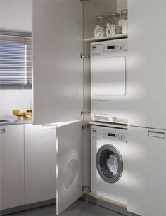 Solutions for the laundry Tall unit containing the washing machine and dryer One of the cupboards contains the washing machine and the dryer and also has room for the washing powder and fabric softener. Larder Cupboard, Pantry Laundry Room, Small Laundry Rooms, Laundry In Bathroom, White Bathroom, Laundry Solutions, Kitchen Storage Solutions, Kitchen Cabinet Manufacturers, Larder Unit