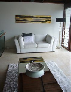 A Panoramic Piece Brings A Finishing Touch Of Elegance To This Lounge Room.