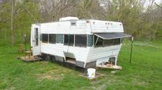 One heck of a coop-but I have issues with this since I would love to have a camper to restore like this!