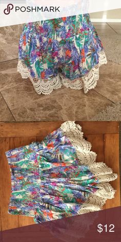 BNWT En Creme Tropical Colorful Print Shorts BNWT Tropical Bright Print Shorts With Scalloped Crochet Hem                                                 NOTE --these shorts look very tiny but have a ton of stretch/// I usually wear a 5 or 7 in shorts and I wear a size a medium in these shorts               Material is 100% rayon en creme Shorts