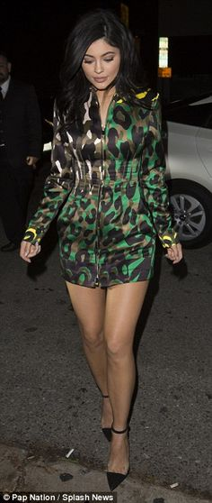 Military chic: Kylie looked incredible in the camouflage dress, which featured a myriad of green hues with neon yellow accents on the cuffs and collar