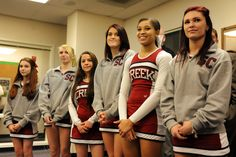 """Sand Creek High School cheerleaders line up for """"Fantastic 49"""" recognition Dec. 11, ahead of a monthly board meeting in District 49. Sand Creek High School's cheer team just had its best year ever, according to coaches Ali Malcolm and Lauren Stuart. The team won the Pikes Peak Athletic Conference girls championship. The team made it to the state finals and finished third in the girls competition."""
