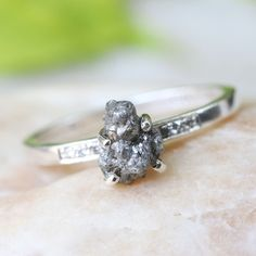 Sterling silver hand textured ring with genuine rough diamond and pave set diamonds on the side