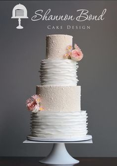 White-on-White Pearl and Ruffle Wedding Cake by Shannon Bond Cake Design - http://cakesdecor.com/cakes/241735-white-on-white-pearl-and-ruffle-wedding-cake