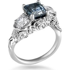 Floral Bouquet Three Stone Engagement Ring - The flowers in this intricate engagement ring design will never wilt! Your center stone sits atop the bouquet, and your side gemstones are set inside petals.