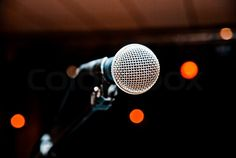 Stock image of 'Microphone in studio on a blur background'