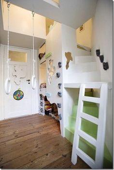 Climbing wall and staircase to loft play room link to all sorts of playroom ideas