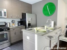 """""""What time is it?"""" you ask this furnished apartment in #Midtown #NYC. """"Why, it's green o'clock my dear!"""" http://www.nyhabitat.com/new-york-apartment/furnished/16314"""
