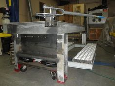 Welding Table- Retractable wheels and receiver up top for tools! Brilliant!