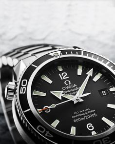Omega Seamaster Planet Ocean - we saw this at the mall the other day and was very impressed. Simple and elegant design.. nothing too fancy but makes a huge statement! Love to own but is quite expensive. ~$8000
