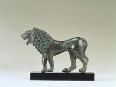 Ambling Lion    Bronze  H: 5.9 cm.  L: 9.1 cm  Allegedly from region of Smyrna  East Greek (School of Chios or Ephesos?)  4th century B.C.