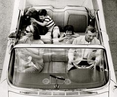 Before seat belts, so much more fun... I remember leaning on the front seat, like that little girl, just to be close to my dad....