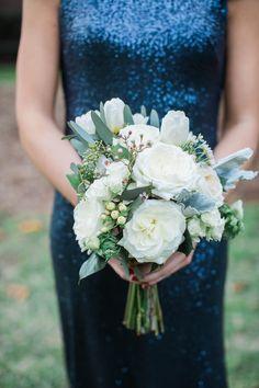 Bridesmaid bouquet with white garden rose, berries, dusty miller, wax flower, spray roses, tulips. Lauren Rathbun Photography.