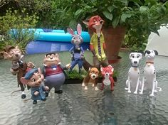 """One of the last orders. Basil, Dawson and Olivia from """"Basil the great mouse detective""""; Judy Hopps and Nick Wilde from """"Zootopia""""; Tod and Toby from """"The fox and the hound""""; and Pongo and Perdita from """"101 Dalmatians"""". Handmade figures. Super Sculpey and cold porcelain. Sculptures."""