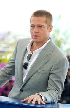 Pin for Later: 52 Years of Epic Brad Pitt Hotness  He struck a laid-back pose while promoting Troy at the Cannes Film Festival in May 2004.