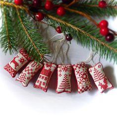 Miniature Cross Stitch Folk Art Christmas Ornaments - Set Two. $18.50, via Etsy.