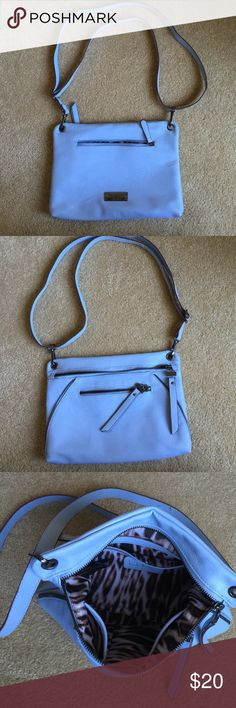 Nicole Miller New York crossbody bag. This bag has been used 2 times. Super soft leather with back zip pocket, front zip pocket, inside zip pocket and 2 slip pockets, all leather trimmed. Adjustable shoulder strap. It is 8 1/2 inches tall by 11 inches wide. This is in perfect condition. Nicole Miller Bags Crossbody Bags