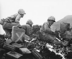 Men of the US 5th Marines Division manning a machine gun, Iwo Jima, Japan, 22 February 1945.