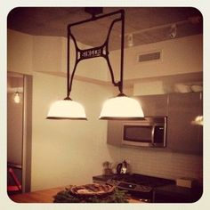 Lighting contemporary using old sewing machine steel by Rusted Maple Carpentry and Design