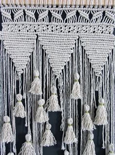 Macrame Wall hanging  gold coloured thread used for tassels  Dimensions:  In Whole: Wood Width 36,5, height including hanging string: 79cm Macrame: Width 36 cm x Height 62,5 cm  This is a handmade Wall Hanging made with string.  You will receive the item in the picture