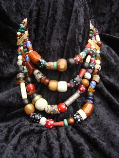 By Nancy Sathre-Vogel | Four strands combing antique trade beads, bone and horn beads, amber, turquoise, and lots more. | 350$
