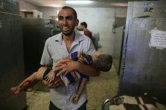His little boy killed by Israeli bomb.