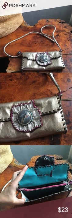 Handmade BoHo crossbody purse Metallic leather and a real center stone. Lovely leather strap and plenty of space for a large smartphone and other goodies. Clean and only lightly used. Free spirit style! 🤸🏻‍♀️❤️ Bags Crossbody Bags