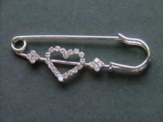 Rhinestone heart pin ideal for shawls or kilts or simply wear as a brooch. This cute pin has been made with a metal alloy that is lead and nickel free. For more pins check out: Shawl Pin, Practical Gifts, Cute Pins, Heart Ring, Brooch, Kilts, Shawls, Metal, Bracelets