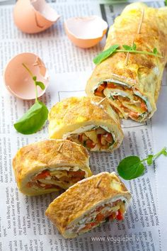 Whoa, omelet roll-ups with fried potatoes, cream cheese, watercress, and peppers. Delightful and delicious.