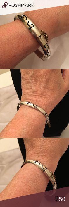 Vintage Sterling Bangle Bracelet with Safety Chain Vintage Sterling Silver Bangle Bracelet with Safety Chain. TAXCO Mexico Sterling with Marker. 8 Inches. Does have a very slight dent shown in photos. Barely Noticeable. Gorgeous Bracelet Vintage Jewelry Bracelets
