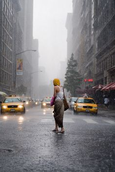 I love this photo, NYC, and the rain!  I want to stand in the middle of NYC in the pouring rain.