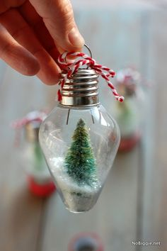 Give your Christmas tree a personal touch with mini snow globe ornaments made from old-fashioned light bulbs and tiny bottle brush trees.