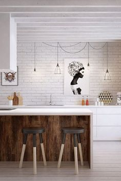 ChicDecó | Exposed wall kitchen • Black and white print • Black dipped stools