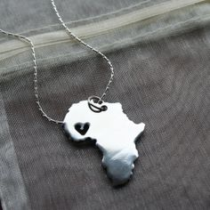 Love for Africa Gold Heart cut out Necklace. I hope to be able to get this when one of my good missionary friends goes out. (: