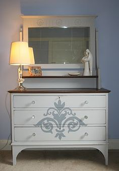 Stenciled dresser.  Have also seen this done with a projector-projecting the image onto the dresser or lamp shade and then paint on.