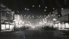 HISTORIC PIC - This photograph depicts 3rd Street in downtown Grand Island, decorated for the holiday season.  This photograph was taken by Henry W. Locke in December 1935.  Join us this weekend at the Stuhr Museum for Christmas Past and Present.  Stuhr's signature event features a beautiful lamp lit tour of Railroad Town, cooking, crafts and gorgeous holiday decorations, live music and the sights, sounds, and smells of the spirit of Christmas.