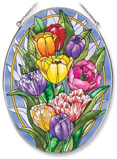 Amia Oval Suncatcher with Tulip Design, Hand Painted Glass, 6-1/2-Inch by 9-Inch by Amia. $24.00. Includes chain. Comes boxed, makes for a great gift. Handpainted glass. Amia glass is a top selling line of handpainted glass decor. Known for tying in rich colors and excellent designs, Amia has a full line of handpainted glass pieces to satisfy your decor needs. Items in the line range from suncatchers, window decor panels, vases, votives and much more.