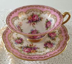 Vintage E.B Foley china tea cup and saucer, made in England. An absolutely stunning set, pink and white with lovely hand painted flowers.