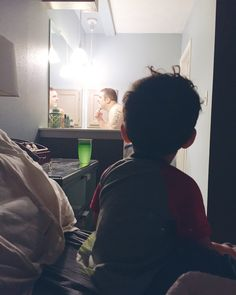Watching daddy shave.