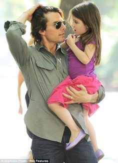 Daddy's Girl! Tom Cruise takes little Suri for a fun day out at the playground
