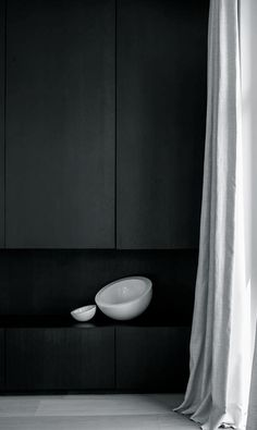Beautiful soft drapery against black cabinetry with John Pawson's Tilty Bowls by Dennis T'Jampens   Project VM   Schilde, Belgium