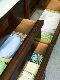 line wood drawers with colorful papers for a fresh pop of color