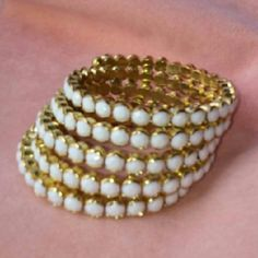 Coil Stone Bracelet This is super chic and super in condition! Adjustable, continuous coil bracelet. Was a hp. Beautiful, sparkling white stone with gold tone metal. Cara NY Jewelry Bracelets