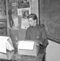 Paul Petersen of ABC-TV's THE DONNA REED SHOW does homework during typing class.