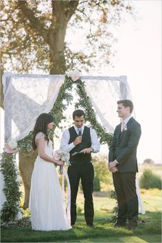 love this lace and eucalyptus wedding ceremony backdrophttp://www.weddingchicks.com/2014/01/31/vintage-barn-wedding-2/