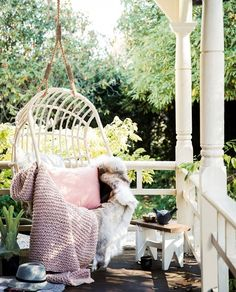 A hanging chair is a great choice for a seat retreat in small gardens as it takes up very little room | Home Beautiful Magazine Australia