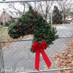 Horse Head Wreath at Driveway Entrance & 10 other ways to add equestrian flare to your Christmas Decorations- at hawk-hill.com