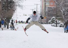 Skiing down Queen Anne Avenue during a Seattle snow storm :)   One winter when the Avenue was closed I hiked up one side.  Got a cardboard box at the top grocery store, and slid down the other side to Dravus St. on the cardboard box.