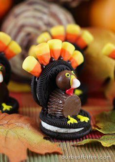 Turkey Cookie Treats    Double Stuff Oreo Cookies  Candy Corn  Whoppers  Peanutbutter Cups  Chocolate frosting  Yellow Frosting  Optional: Red frosting  Optional: black sprinkles for eyes